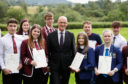 Deputy First Minister and Education Secretary John Swinney with pupils from Forth Valley College in Stirling who received their SQA exam results