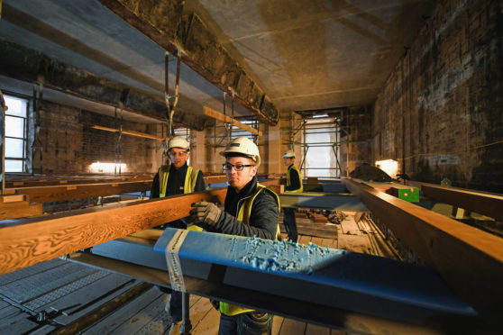 Specialist carpenters from Lawrence McIntosh install the floor to the bookstore above the Mackintosh Library on November 22, 2017 in Glasgow, Scotland.The original floor was suspended from beams above the book store by metal stirrups which survived the fire and are being retained in the restored building Restoration of Glasgow School.