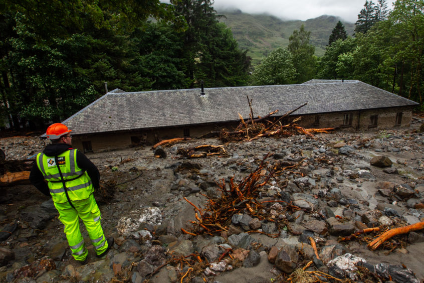 Holiday cottages on Loch Katrine with severe damage caused by landslides