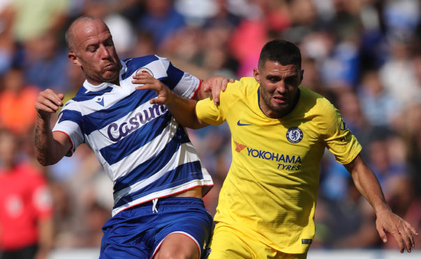Charlie Adam battles with Mateo Kovacic of Chelsea in a friendly