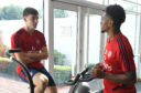 Arsenal newboy Kieran Tierney in the gym with teammate Reiss Nelson