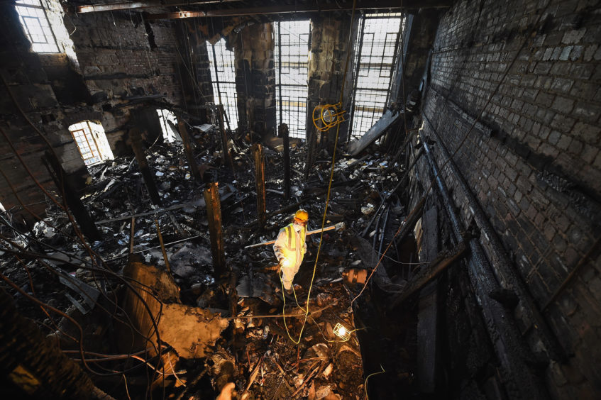 A forensic archaeologist sifts through the ashes of famous Mackintosh library after the first fire in 2014