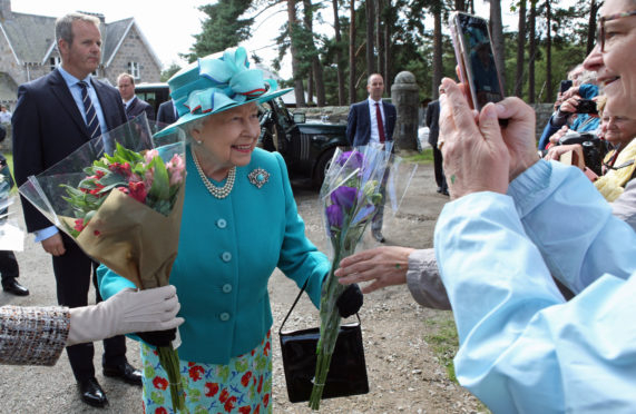 The Queen receives flowers yesterday