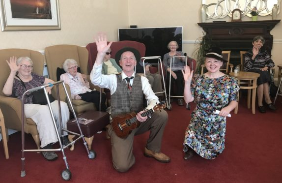 Steve Cooper and Sophie Osborne perform at an Edinburgh care home