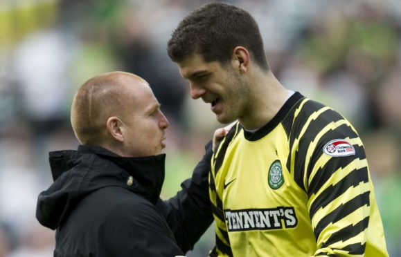 Celtic manager Neil Lennon (left) celebrates with Fraser Forster after a match in 2011
