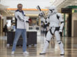 Christopher Lambert poses with a Stormtrooper