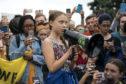 Swedish climate activist Greta Thunberg with other student environmental advocates