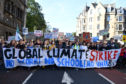 Campaigners protest during a climate change action day on September 20, 2019 in Edinburgh, Scotland. Protests are taking place today worldwide, with campaigners demanding that governments and corporations take steps towards lowering CO2 emissions and combating the warming of the Earth's temperatures.