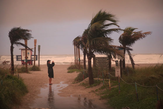 A woman on Cocoa Beach, Florida on Friday as Hurricane Dorian hits