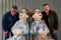 The Proclaimers, Charlie and Craig Reid, signing Oor Wullie statues for the Bucket Trail. The statues have been designed in honour of the Scottish singers. Pic shows Craig (L) and Charlie (R).