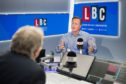 Former prime minister David Cameron during an interview with presenter Nick Ferrari in the LBC studios at Global Radio in Leicester Square, London.