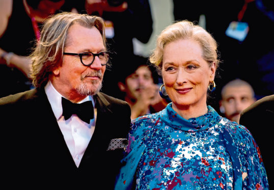 Meryl Streep with co-star Gary Oldman on the red carpet