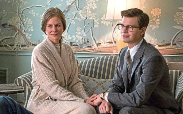 Nicole Kidman stars as the wife of a socialite friend who looks after Theo, right, played by Ansel Elgort