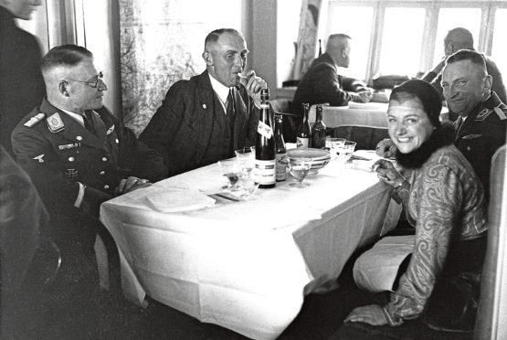 Diners aboard the Hindenburg, so-called Titanic of the Skies, in 1936