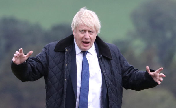 Prime Minister Boris Johnson during a visit to Darnford Farm in Banchory today