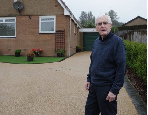 """Douglas Paton paid £6k for a new driveway to be laid - but cheap material was used by a firm of """"belligerent local cowboys"""" and the driveway surface has discoloured and is getting worse."""