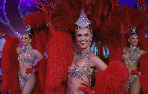 Dancers Lucy Monaghan, Sarah Tandy and Michaela Rondelli, left to right,                 on stage at the Moulin Rouge in Paris
