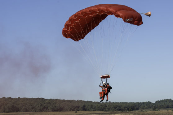 Veteran Sandy Cortmann, 97. The Parachute Regiment veteran from Aberdeen, arrived at the Ginkel Heath commemorations by a tandem jump with The Red Devils British Army Parachute display team as part of the Operation Market Garden 75th anniversary commemorations near Arnhem, Netherlands.