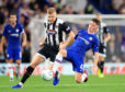 Grimsby Town's Eliott Whitehouse (left) and Chelsea's Billy Gilmour battle for the ball during the Carabao Cup, Third Round match at Stamford Bridge