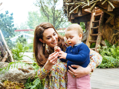 Duchess of Cambridge with Prince Louis in her garden at Chelsea Flower Show.