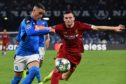 Napoli's Spanish forward Jose Callejon (L) challenges Liverpool's Scottish defender Andrew Robertson during the UEFA Champions League Group E football match Napoli vs Liverpool on September 17, 2019 at the San Paolo stadium in Naples.