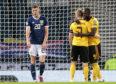 Scotland's Ryan Christie (left) after Belgium's Romelu Lukaku celebrates scoring with Kevin De Bruyne