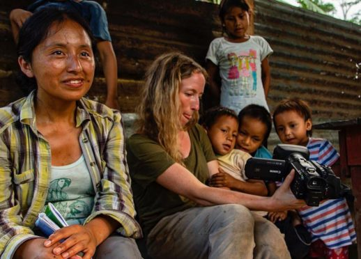 Shirley (l) and Eilidh (r) with children from the Shipetiari community in the Manu National Park