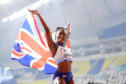 Dina Asher-Smith of Great Britain celebrates after winning gold in the Women's 200 metres final