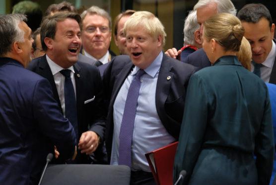 UK Prime Minister Boris Johnson and Luxembourg Prime Minister Xavier Bettel (L)