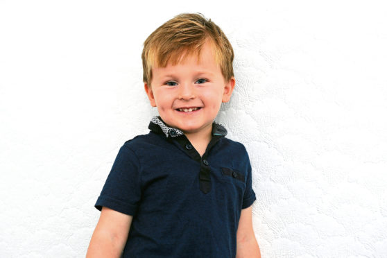 27-09-2019. Picture Michael Gillen. GRANGEMOUTH. Stephanie Smith and son Logan Neilson (4) - he called emergency services when she collapsed and blanked out while cleaning a house in Bonnybridge.