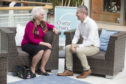 Ina Sellars, 79, from Paisley, talks to Finance Secretary, Derek MacKay on intu Braehead's new Chatty Chairs.