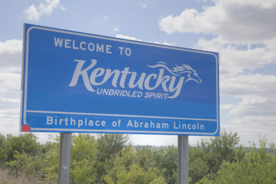 Welcome to Kentucky road sign at the state border.