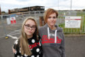 Caroline Taylor and daughter Hannah outside fire damaged Woodmill school in Dunfermline
