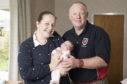 Helen and Paul Noble back home with baby Amber after an unexpected delivery