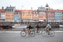 Tourists biking at Nyhavn, Copenhagen