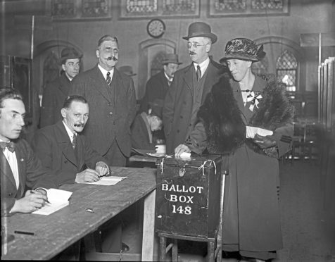 Mrs Mawbey is the first person to cast her vote at a polling station in Dulwich, south London, during the UK general election, 6th December 1923. (Photo by Topical Press Agency/Hulton Archive/Getty Images)