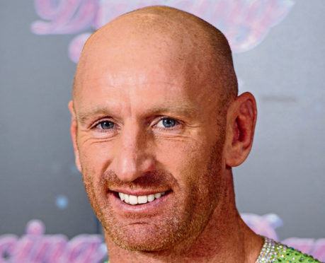 Former Wales rugby captain Gareth Thomas who is taking part in a 140-mile Ironman triathlon, a day after revealing he is HIV positive.