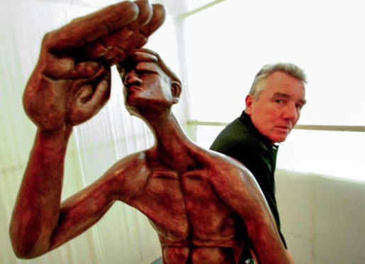Sculptor and convicted murderer Jimmy Boyle with some of his work at an exhibition in Edinburgh.