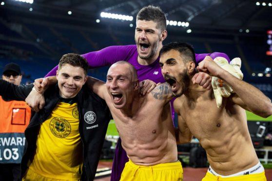 James Forrest, Scott Brown, Fraser Forster and Hatem Elhamed celebrate with the travelling support after beating Lazio