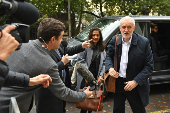 Labour Party leader Jeremy Corbyn arrives for a Labour clause V meeting on the manifesto at Savoy .