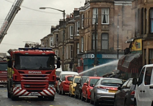 """Firefighters were still at the scene on Tuesday afternoon carrying out an """"extensive dampening down operation"""""""