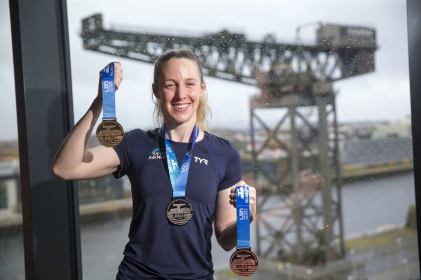 Hannah with the medals, which feature the iconic Finnieston Crane