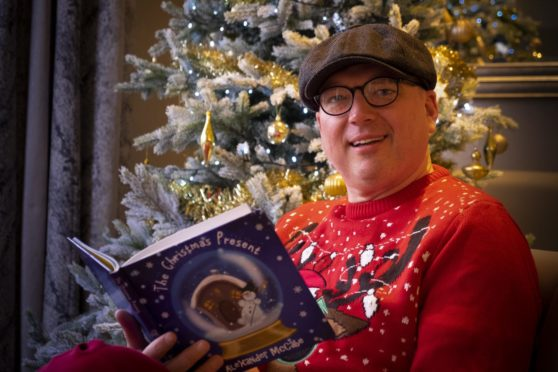 Alexander McCabe with his book, The Christmas Present.