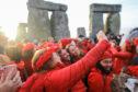 People taking selfies at Stonehenge