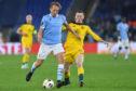 Callum McGregor up against Lucas Leiva of Lazio during Celtic's Europa League win in Rome