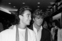 Wham's Andrew Ridgeley and George Michael (right)