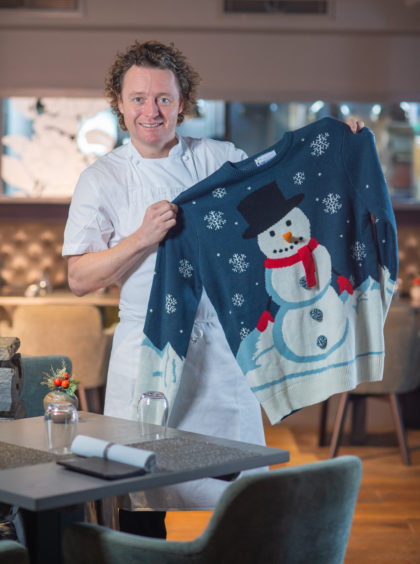 Chef Tom Kitchen in his Edinburgh restaurant The Kitchin with a Christmas jumper for Save the Children Christmas jumper appeal.