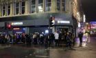 Crowds brave the rain to join the long queue on Wednesday night in Newcastle to be first to try Greggs' vegan steak bake