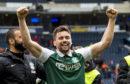 Hibs defender Darren McGregor celebrates at full time after knocking out Dundee United