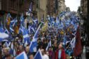 Thousands of people take part in an 'All Under One Banner' march for Scottish independence